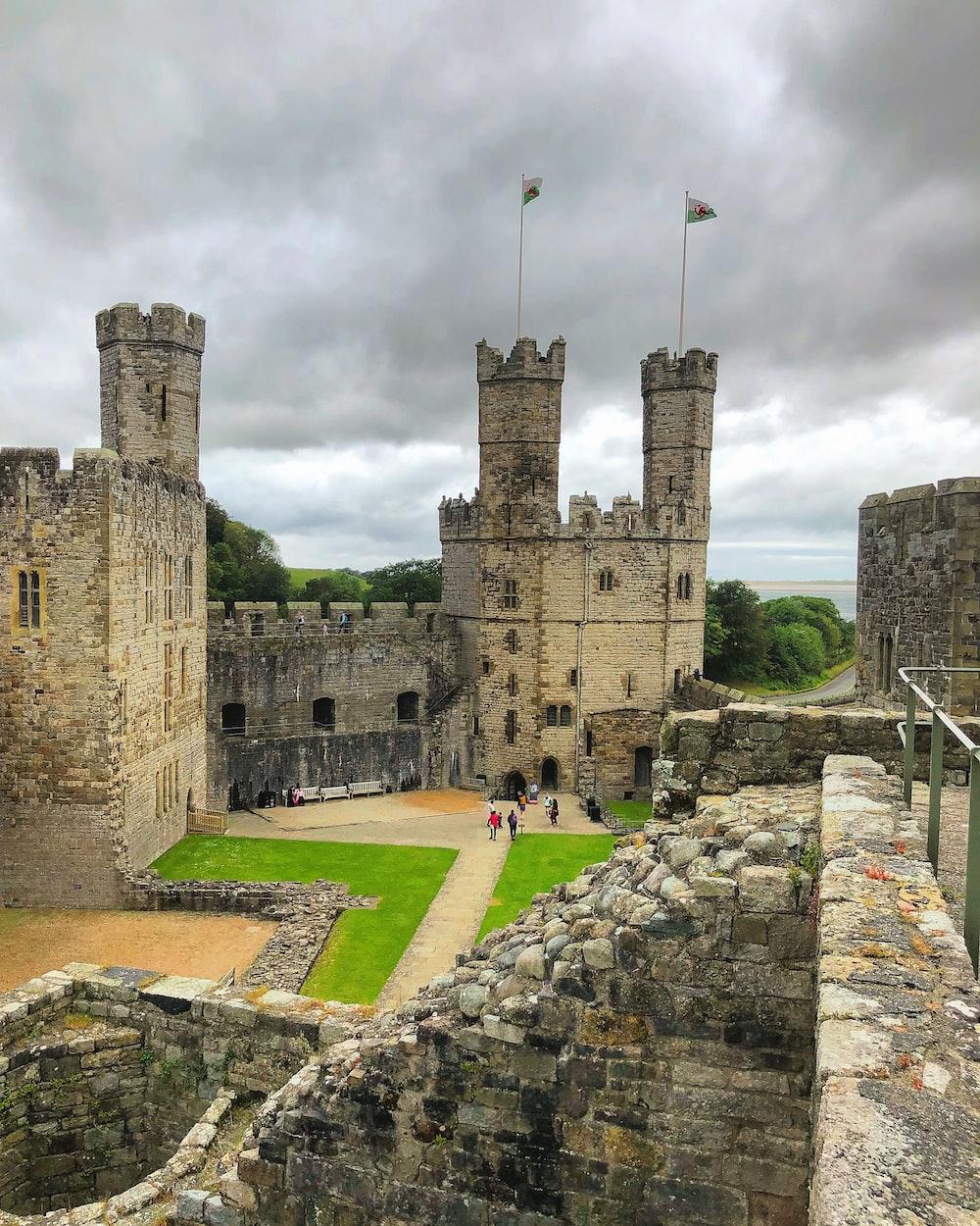 gray concrete castle under gray sky