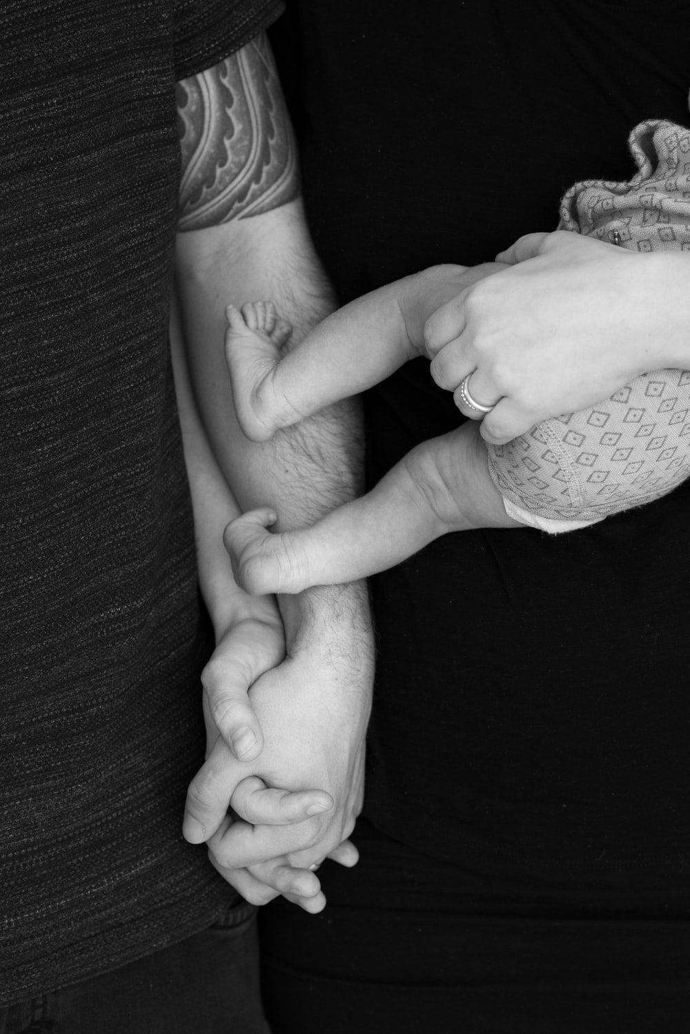 grayscale photo of couple holding hands