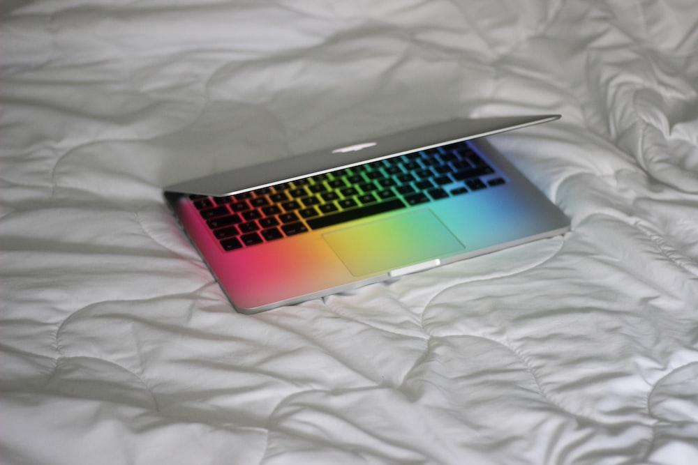macbook pro on white textile