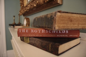 brown hardbound book on white table