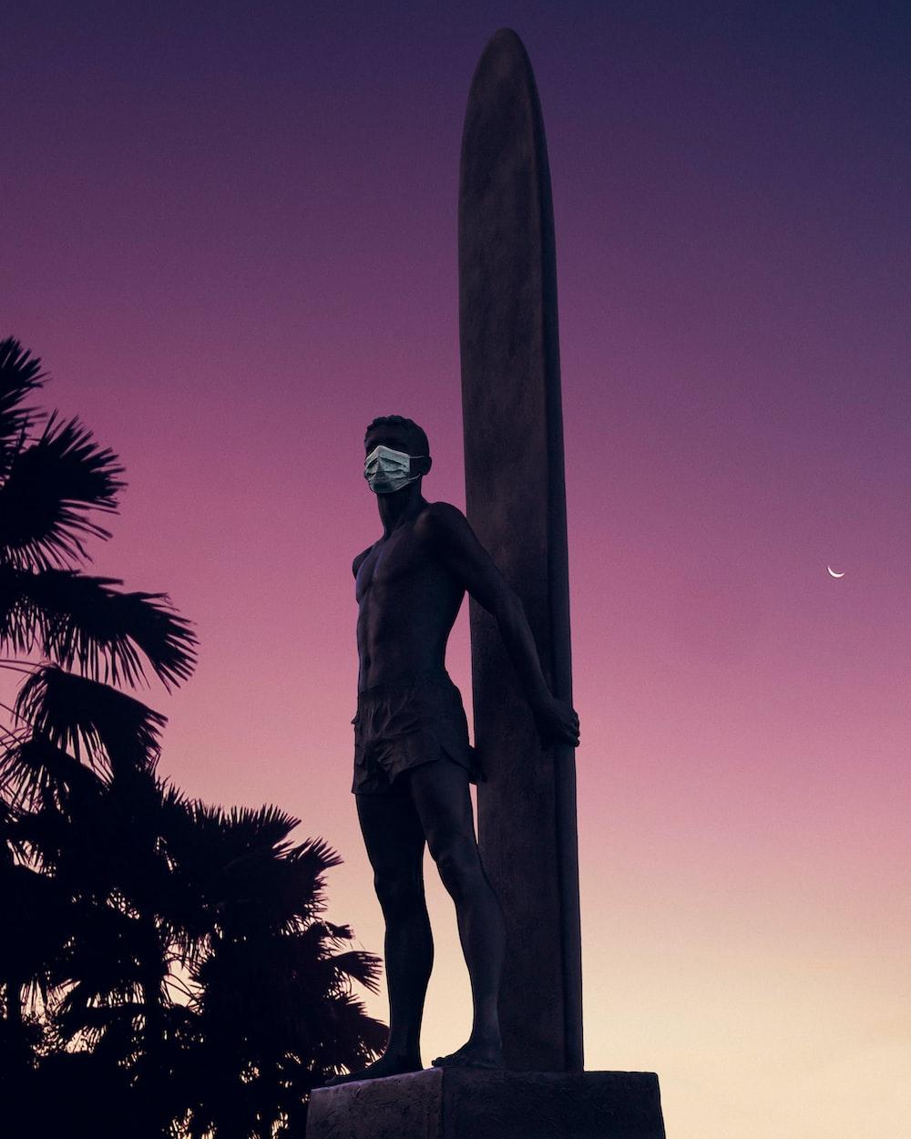man in black pants statue