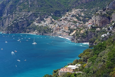 aerial view of body of water near green trees and houses during daytime amalfi coast zoom background
