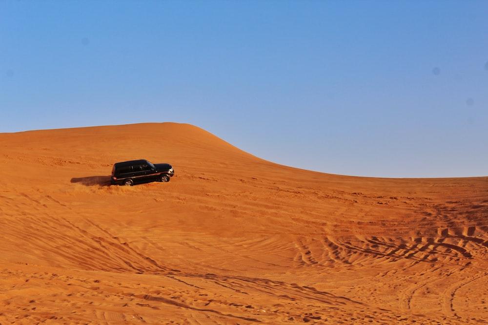 black suv on desert during daytime