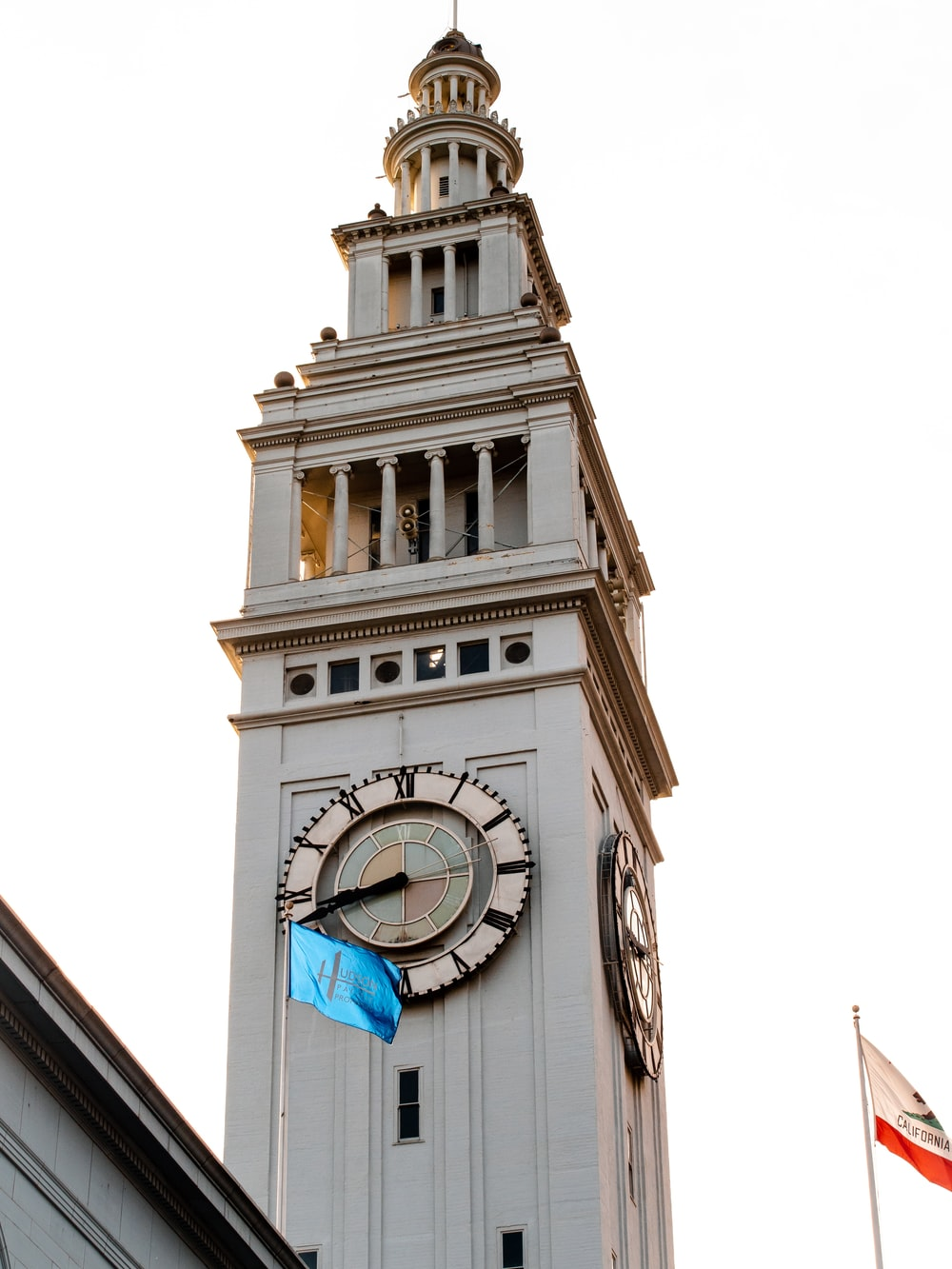 white and blue tower clock