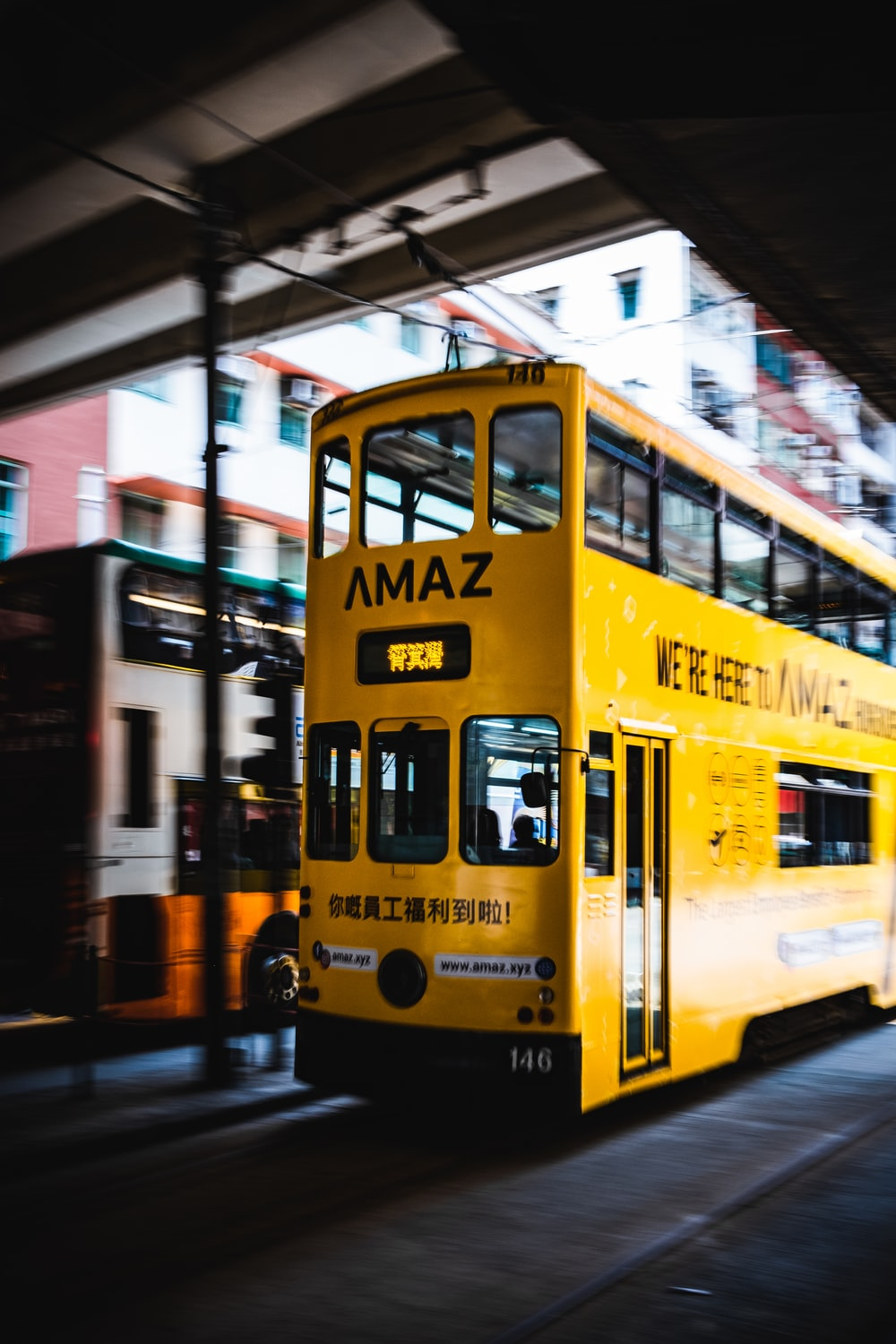 yellow and white bus on road during daytime