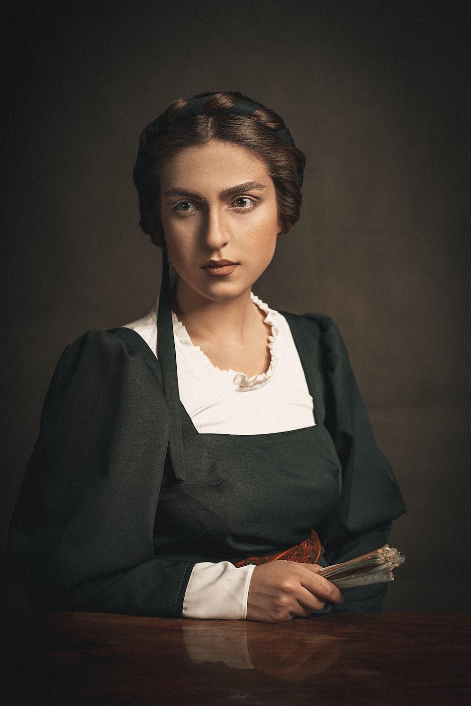 woman in black blazer and white dress