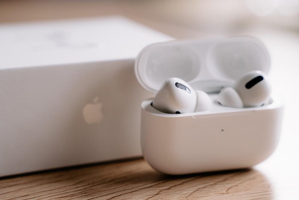 white apple earpods in white plastic case