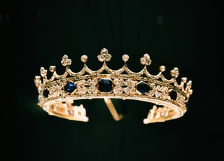 silver diamond studded crown with black background