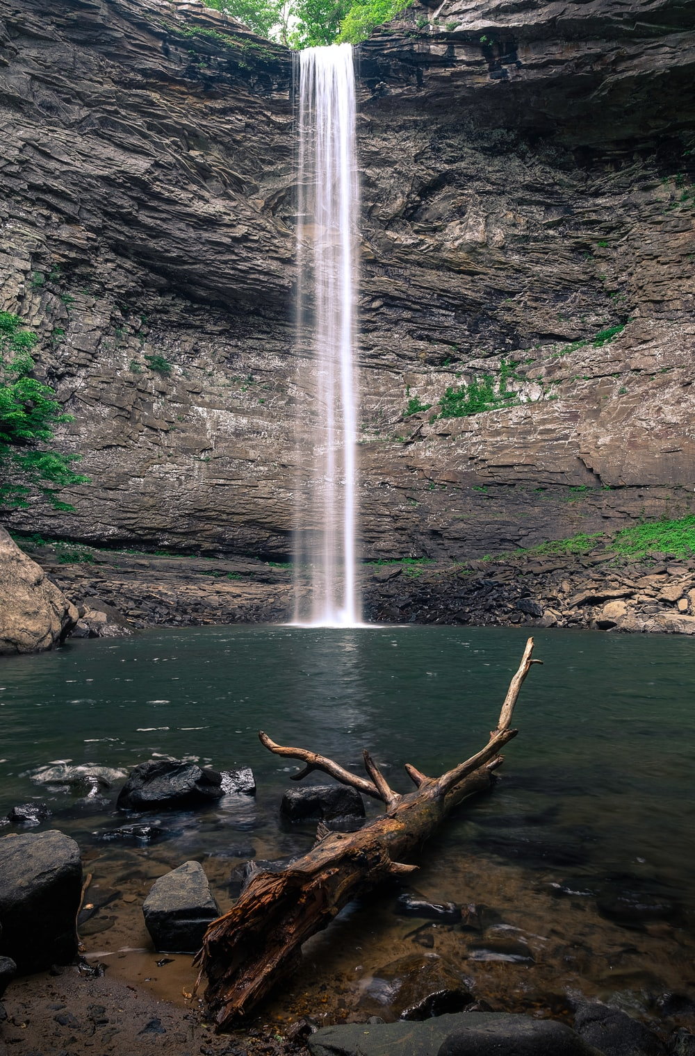 waterfalls on rocky mountain during daytime