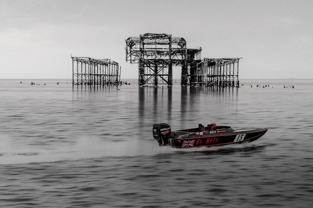 red and white personal watercraft on sea