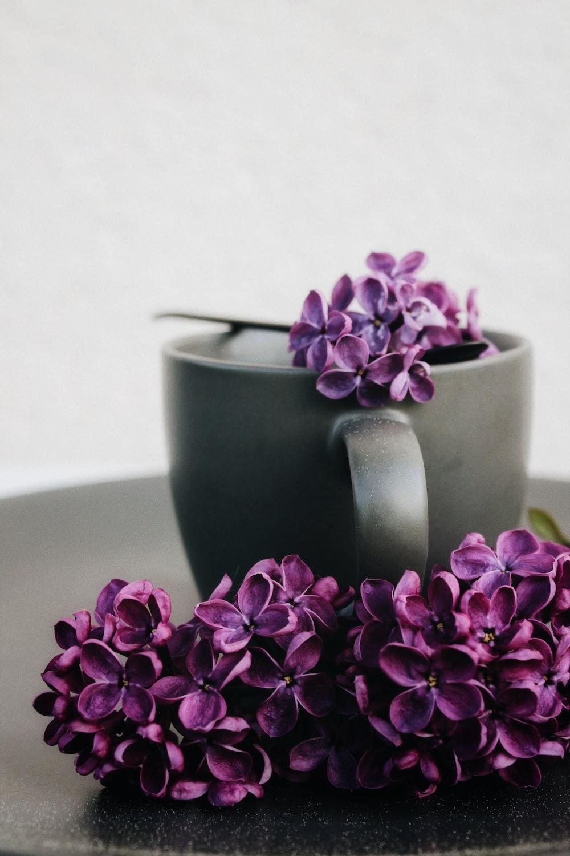 pink flower on green ceramic mug