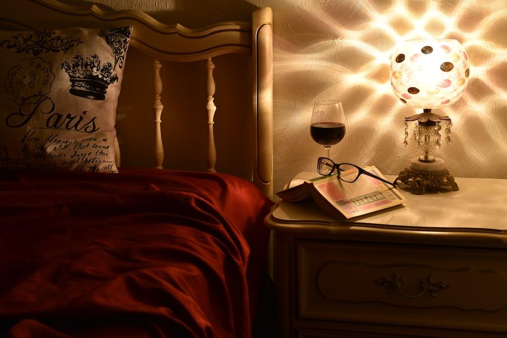 black framed eyeglasses on brown wooden nightstand