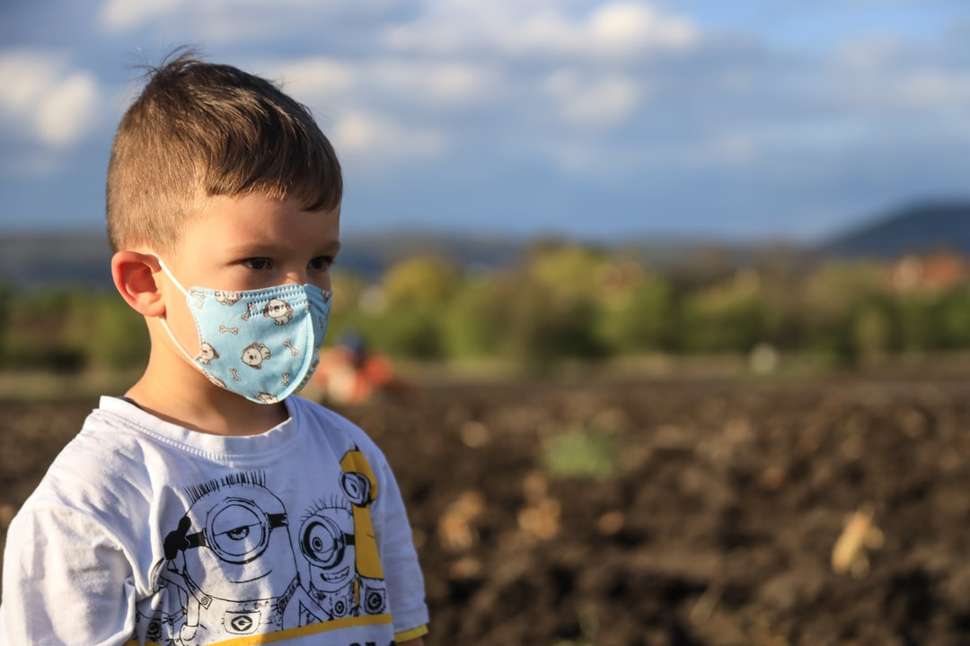 Kid with face protective mask
