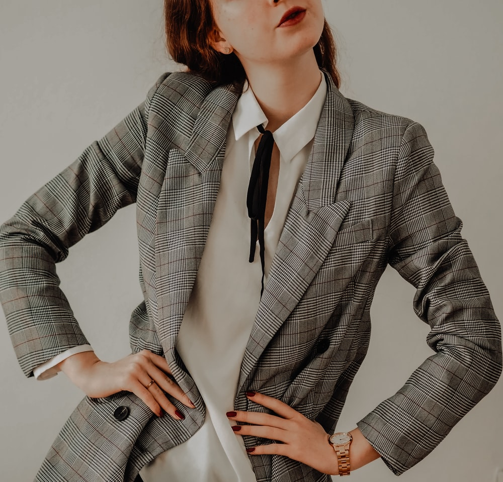 woman in gray blazer and white dress