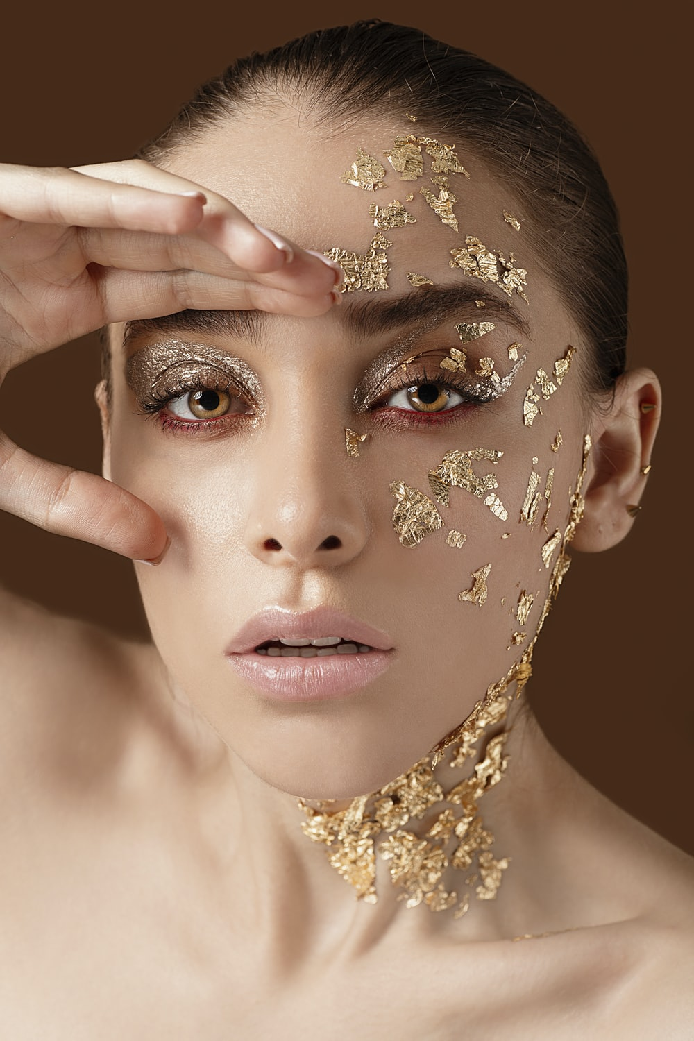 woman with gold floral face paint