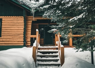 brown wooden staircase covered with snow