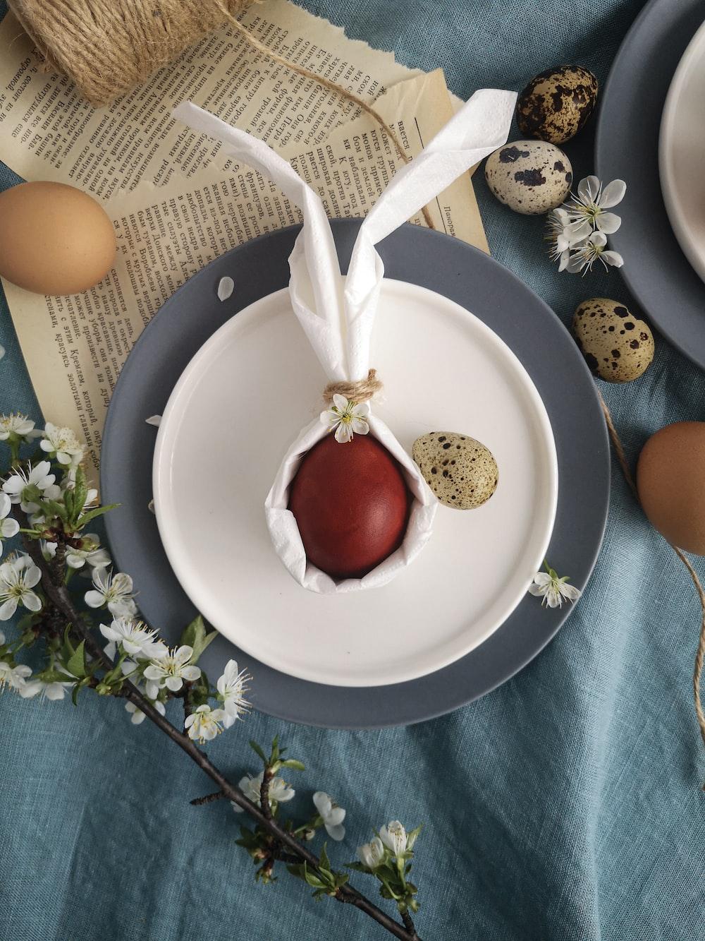 red cherry fruit on white ceramic bowl