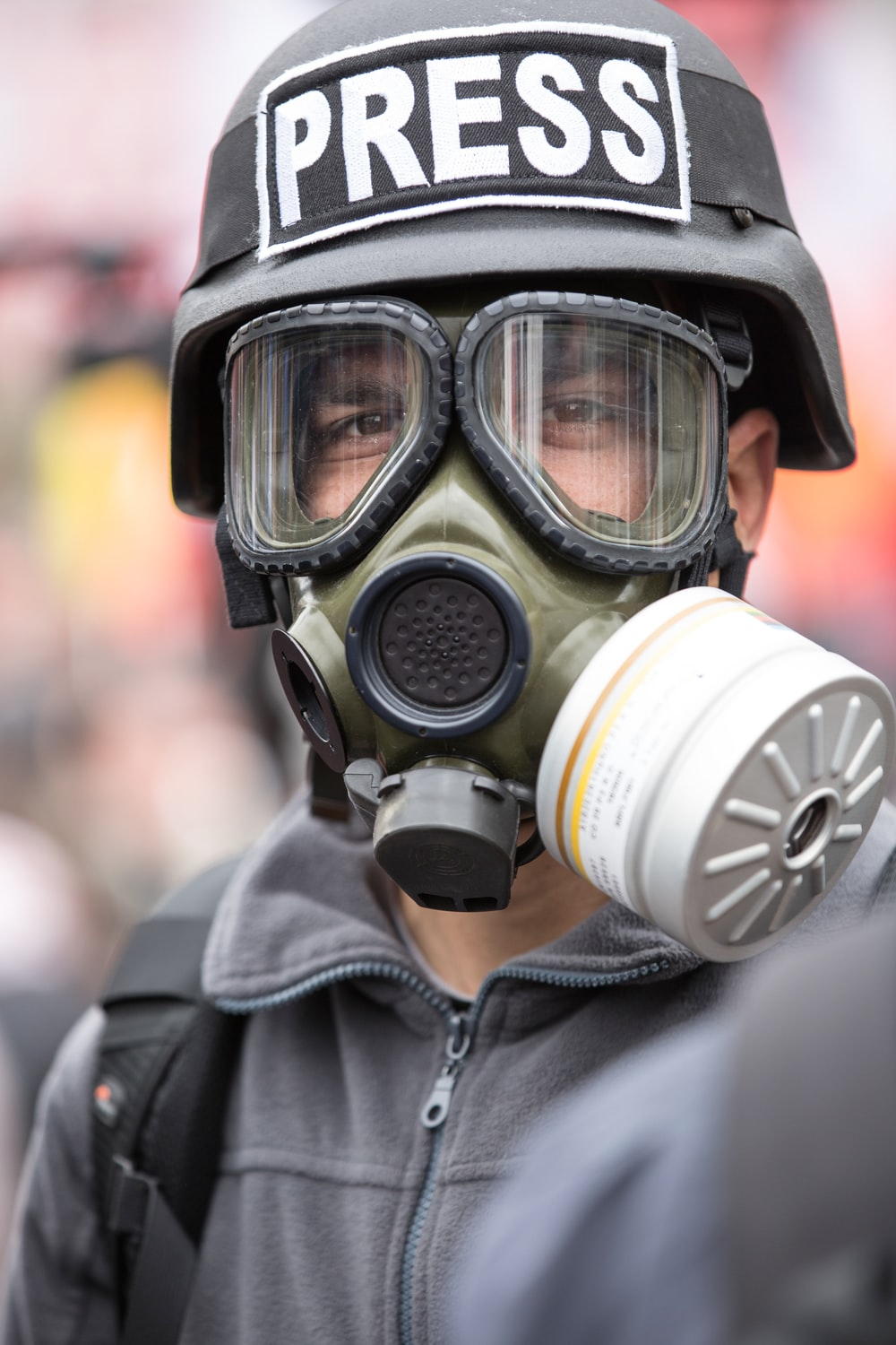 person wearing black and white gas mask
