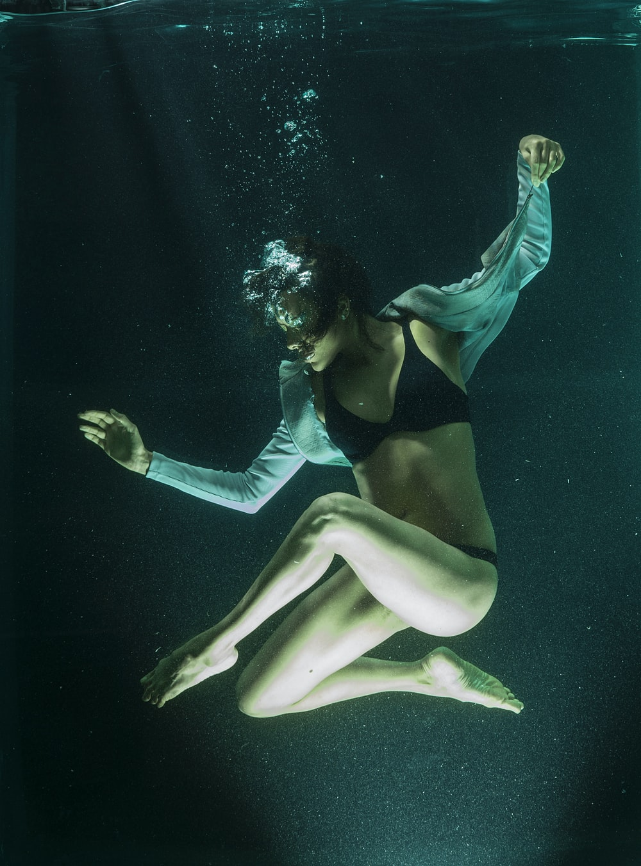 woman in black bikini under water