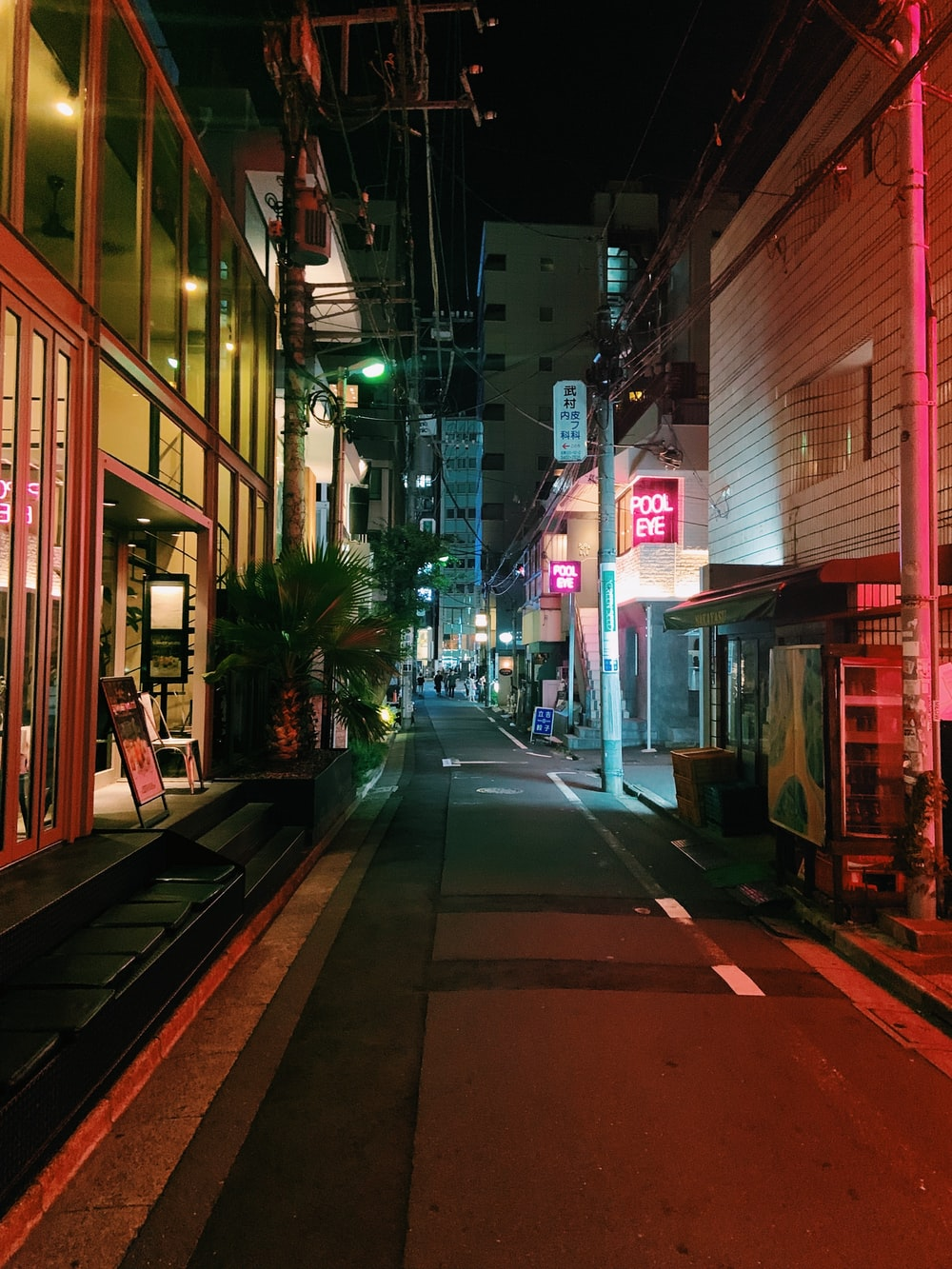 empty street with lighted street lights during night time