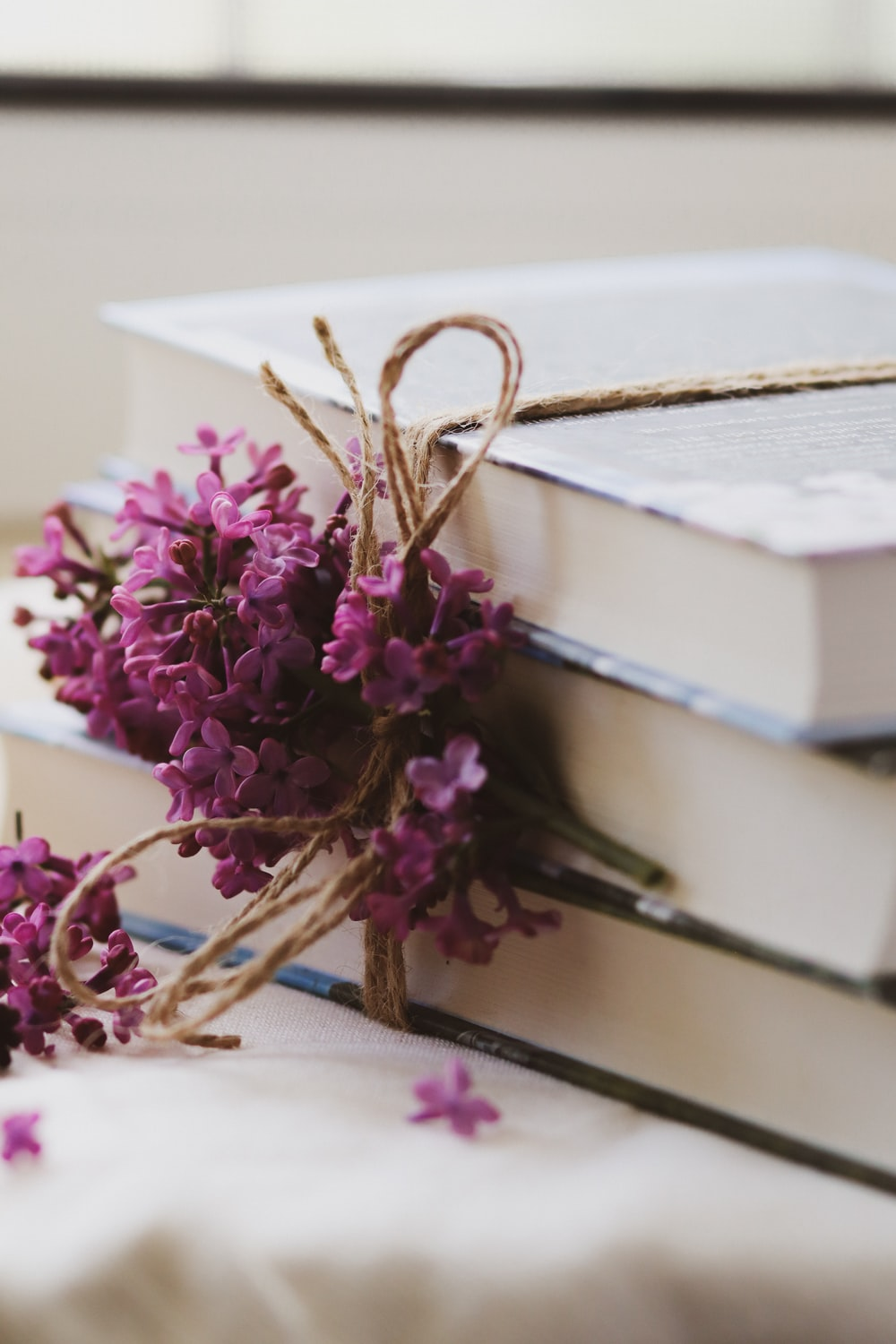 purple flowers on white book page