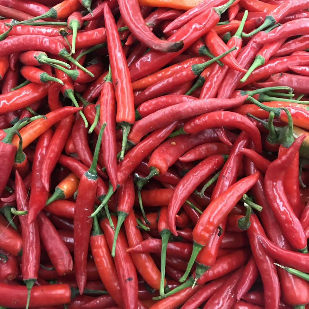 red chili lot on black textile