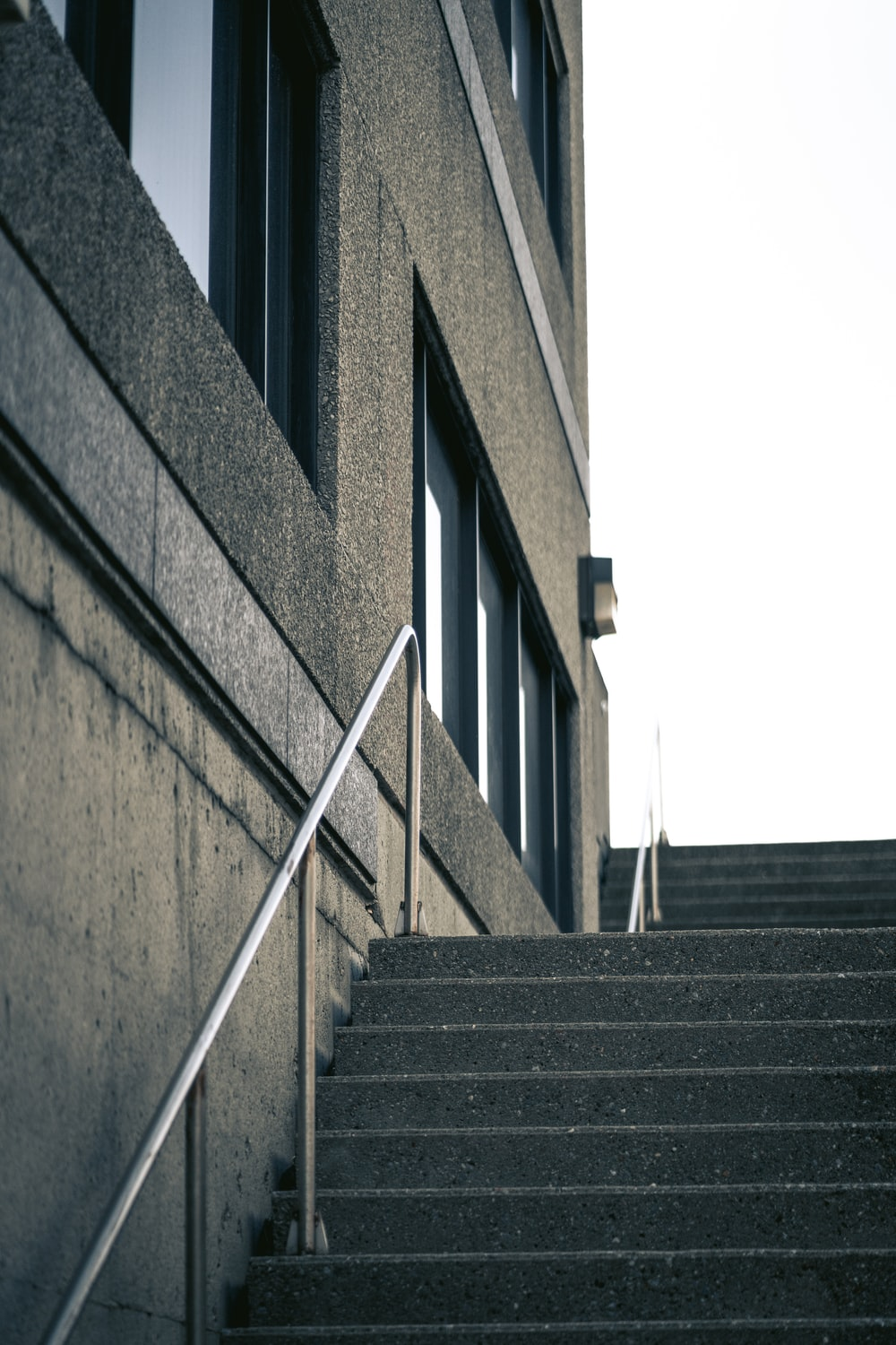 black staircase in front of brown concrete building