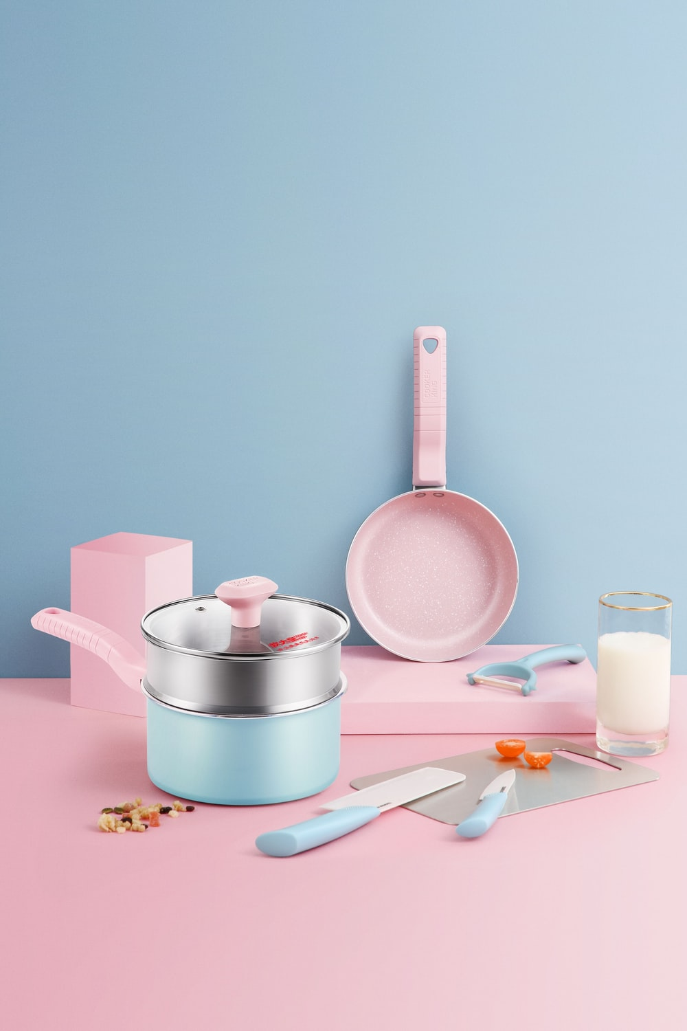 stainless steel cooking pot on pink table