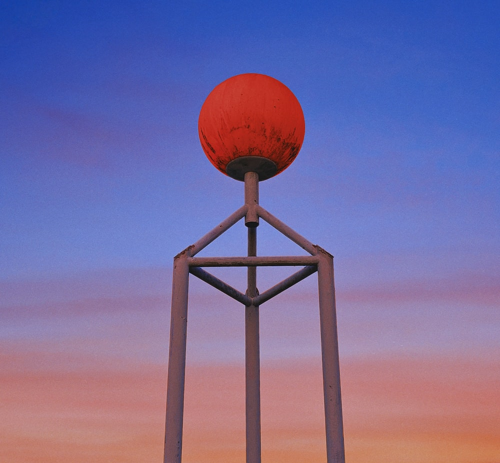 orange basketball on white wooden stand