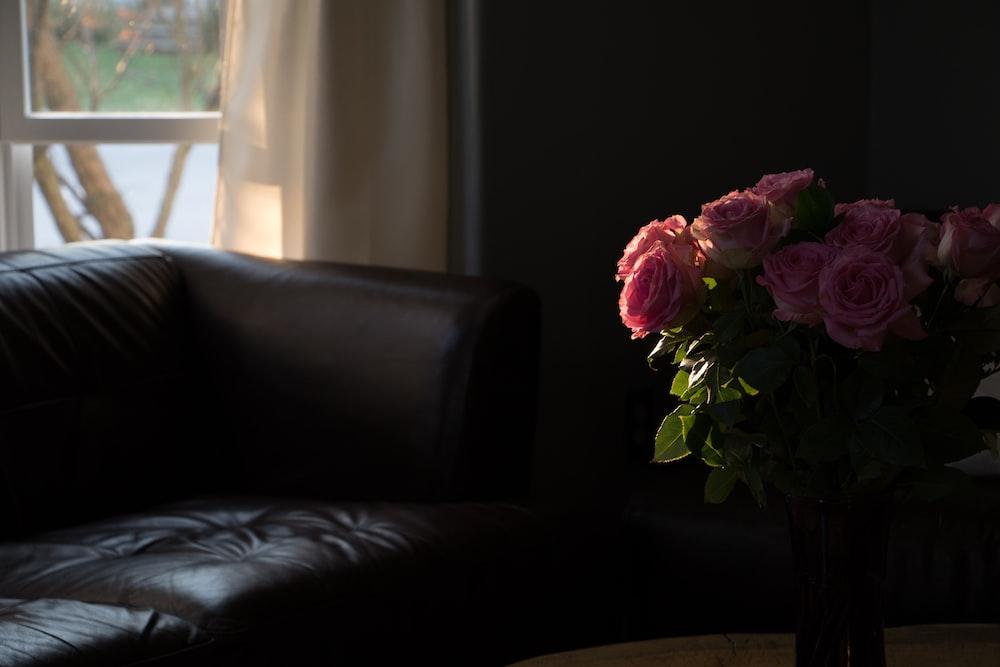 pink roses on black sofa