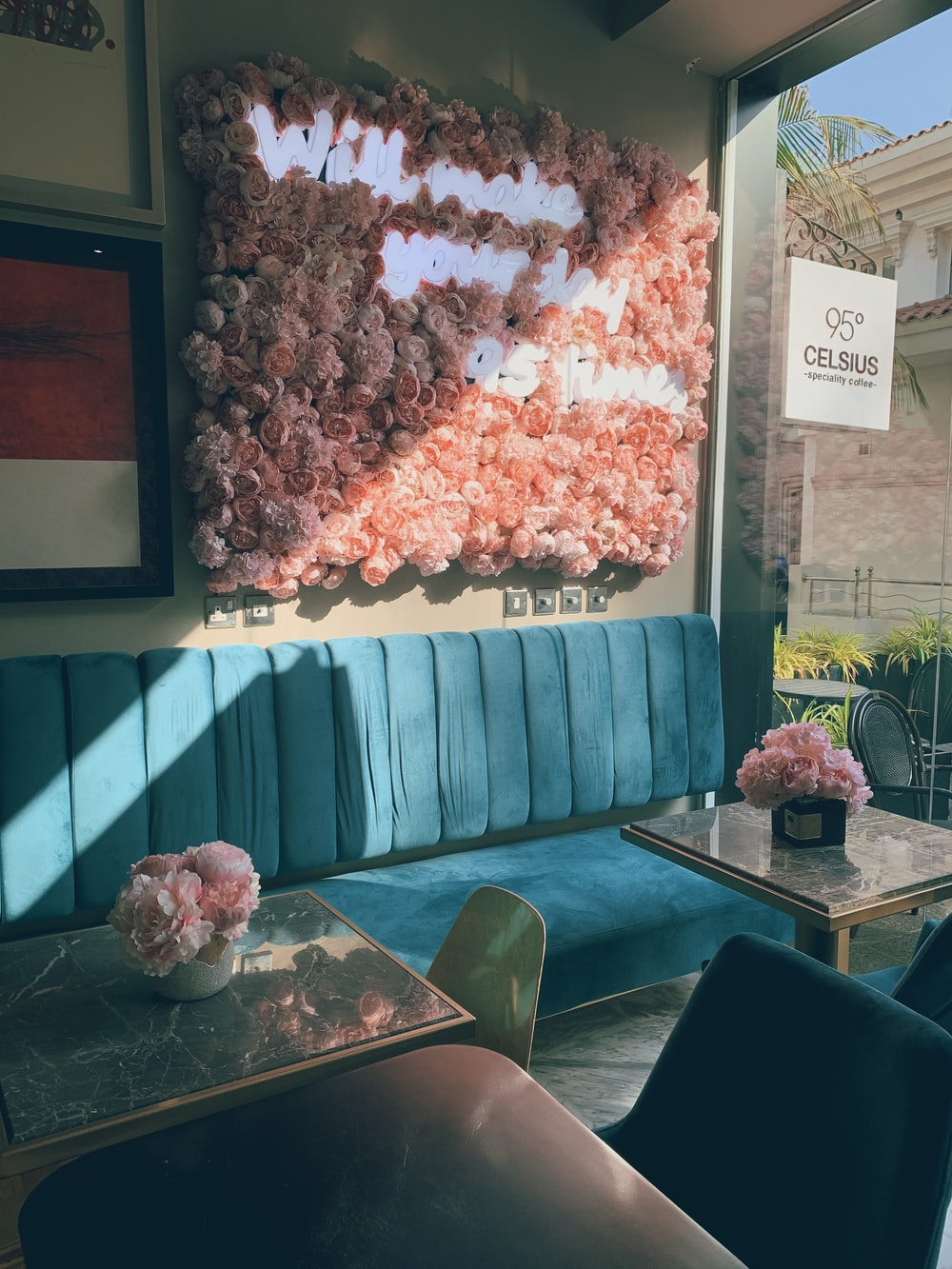 pink flowers on green sofa