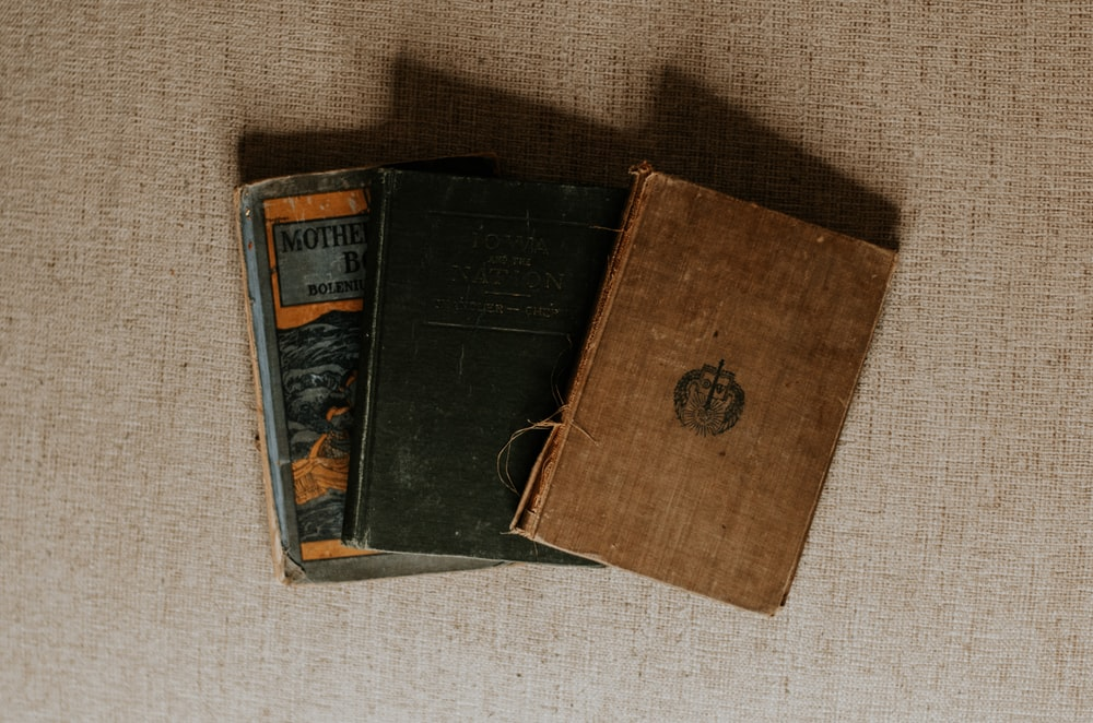 brown and black labeled book
