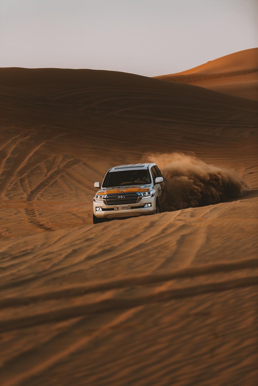 white chevrolet car on desert