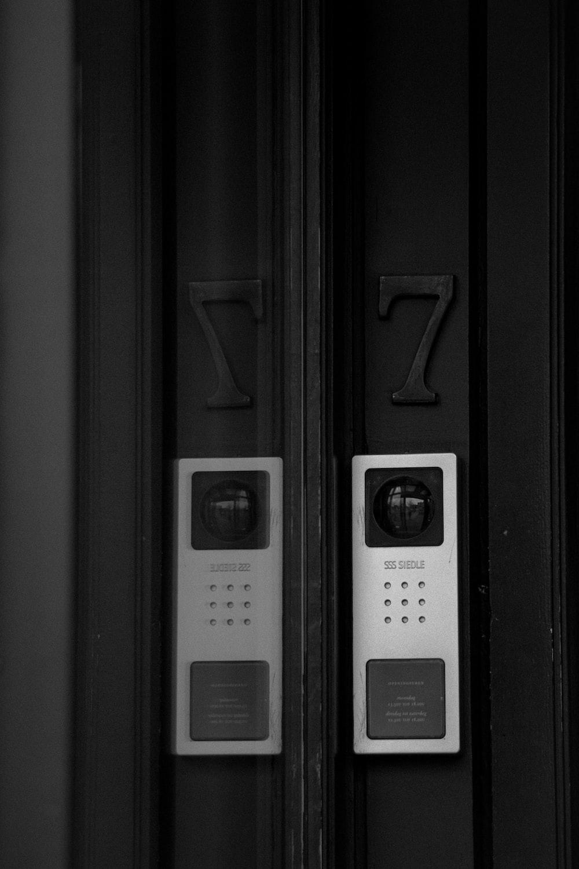 grayscale photo of train door