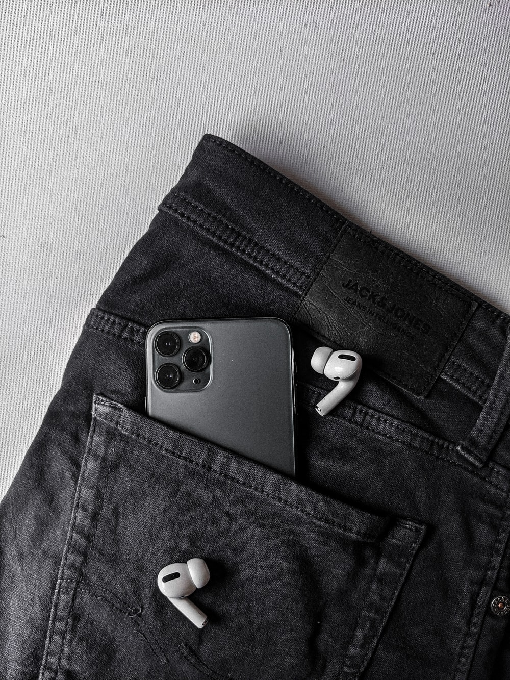 white and black game controller on blue denim jeans
