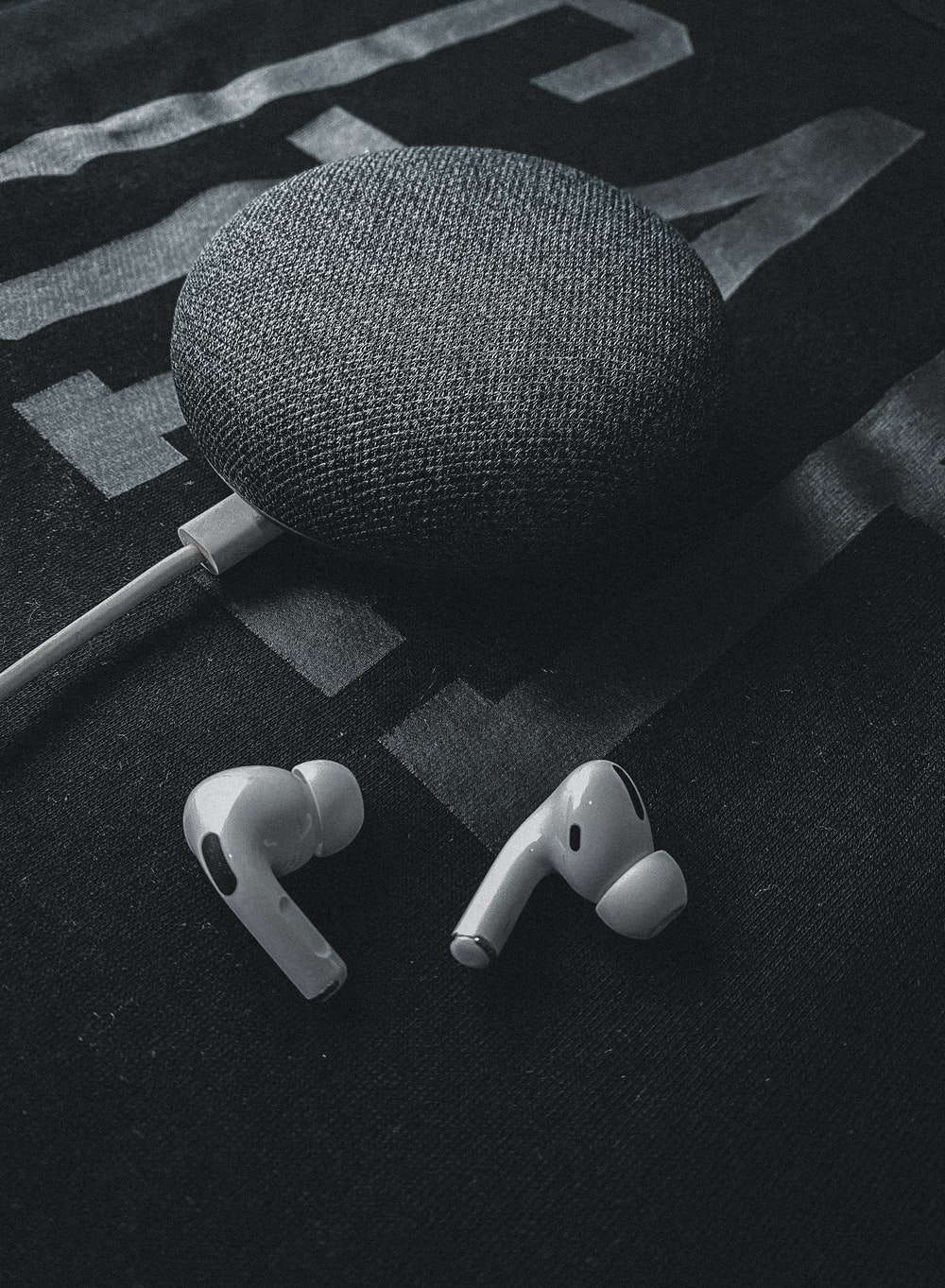 white earbuds on black textile