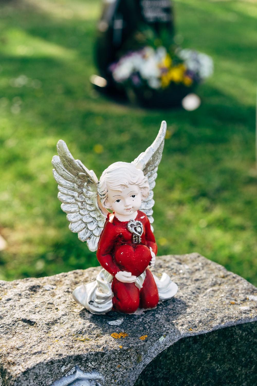 angel ceramic figurine on gray concrete surface
