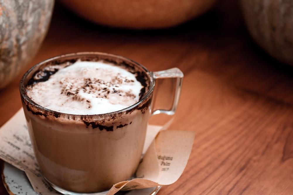 brown ceramic mug with coffee