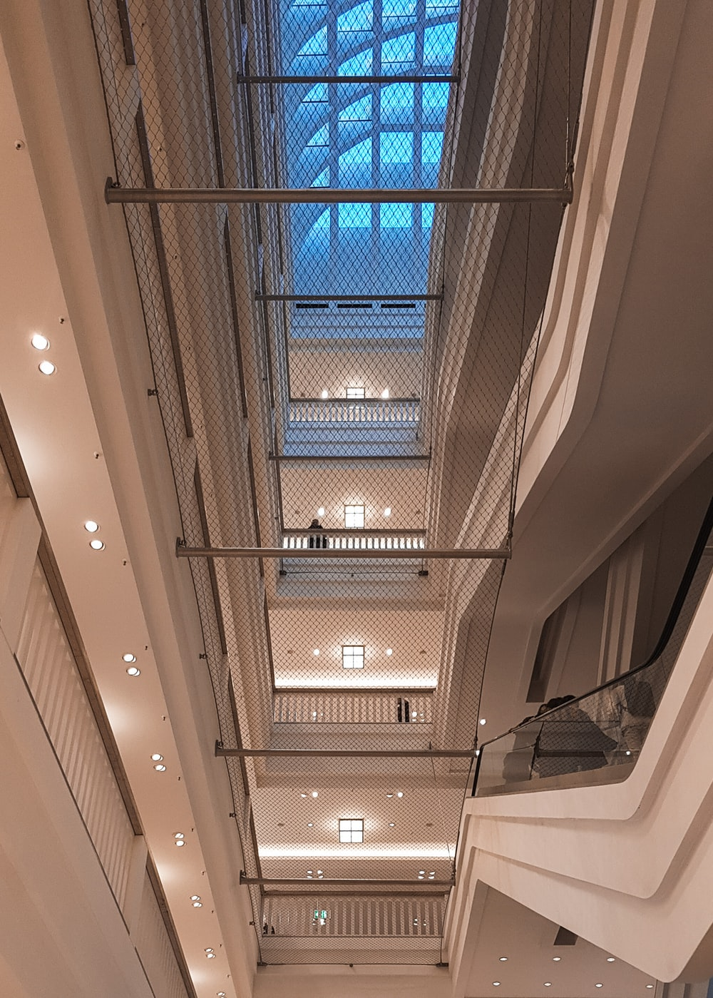 white ceiling with blue glass windows