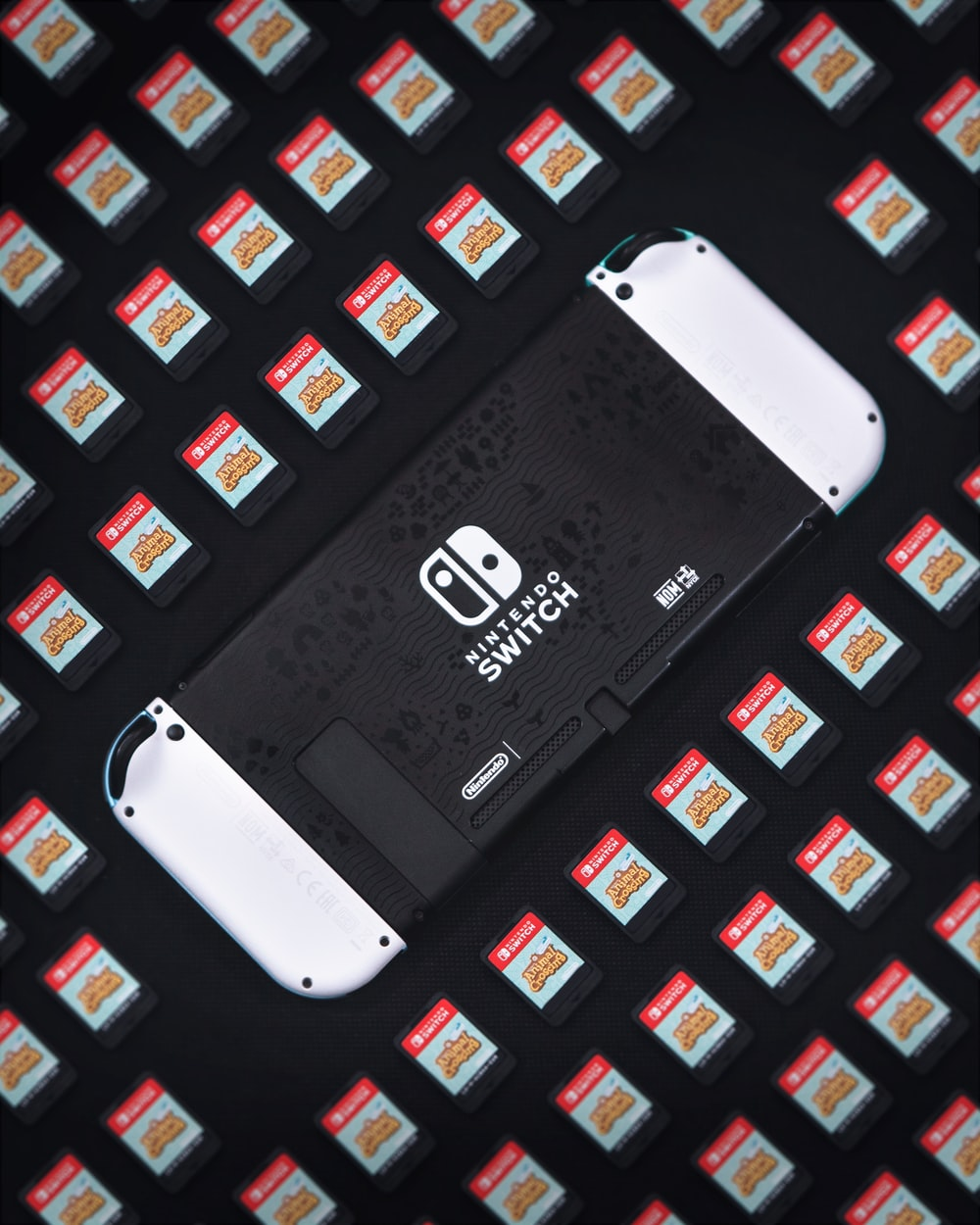white and black smartphone on black and blue textile