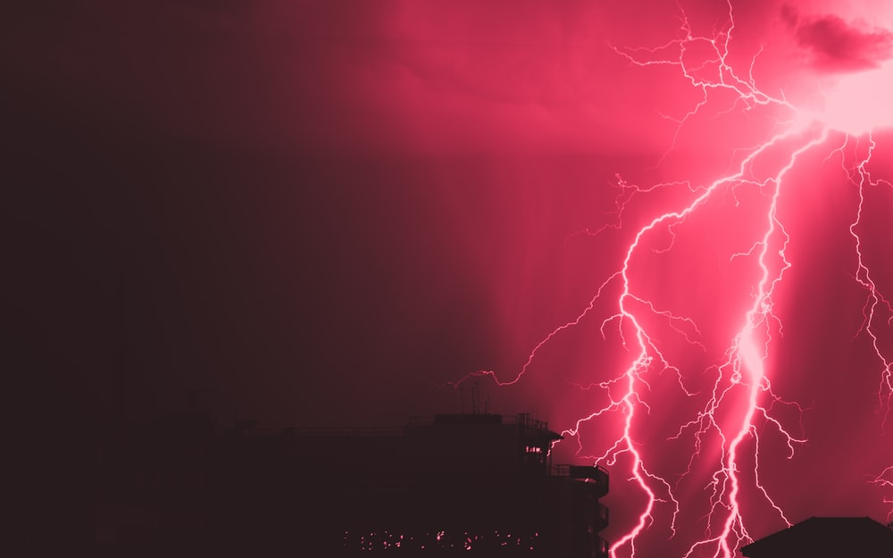 red and blue lightning during night time