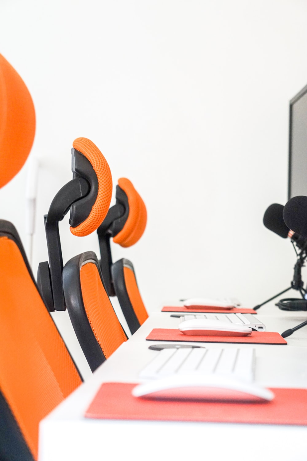 black and orange office rolling chair