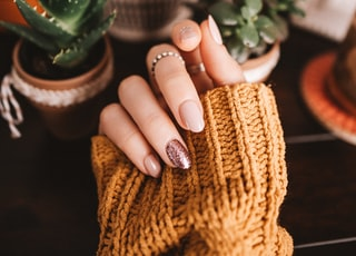 person holding brown woven basket