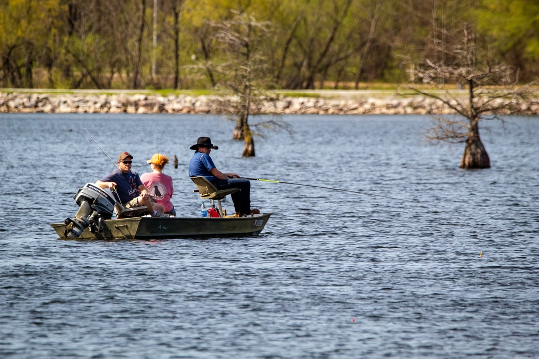 People fishing in Oneal Lake at the Hatchie National Wildlife Refuge.