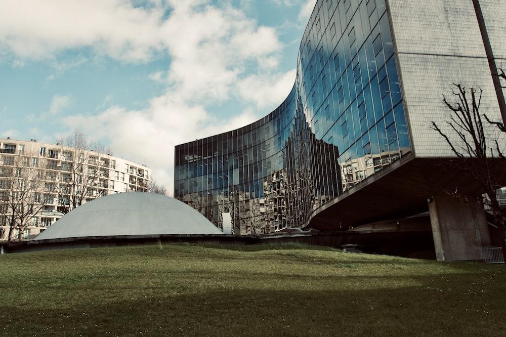 glass building under blue sky during daytime