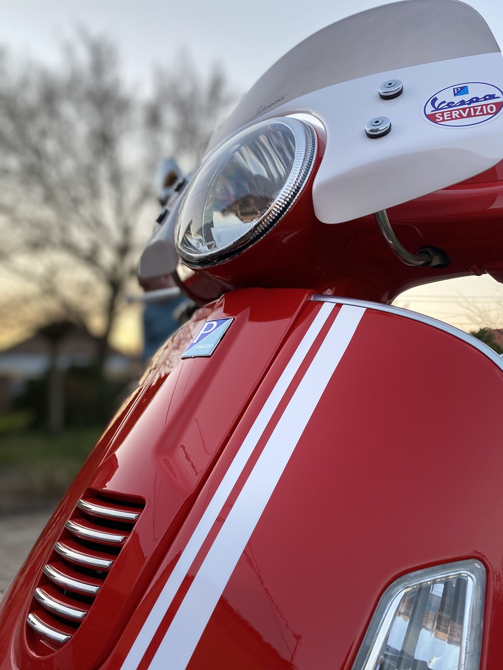 red and white motorcycle in tilt shift lens