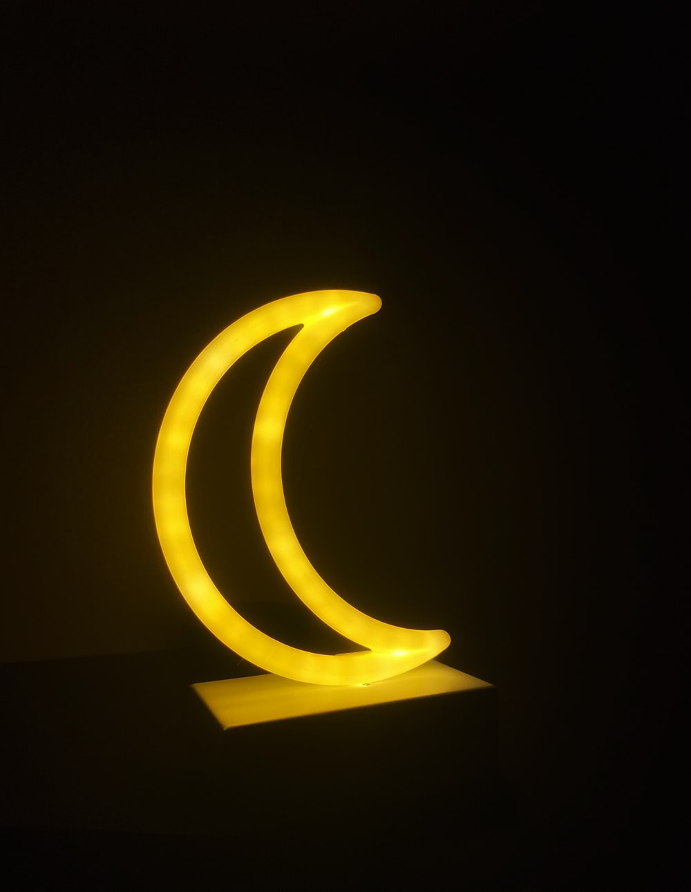 yellow spiral light in dark room