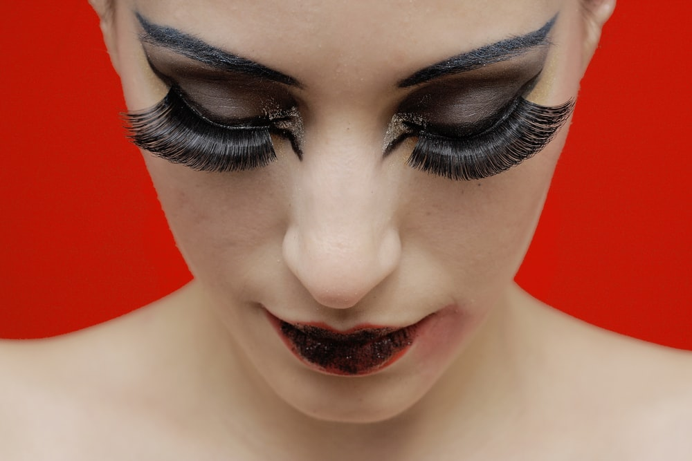 woman with black lipstick and red lipstick