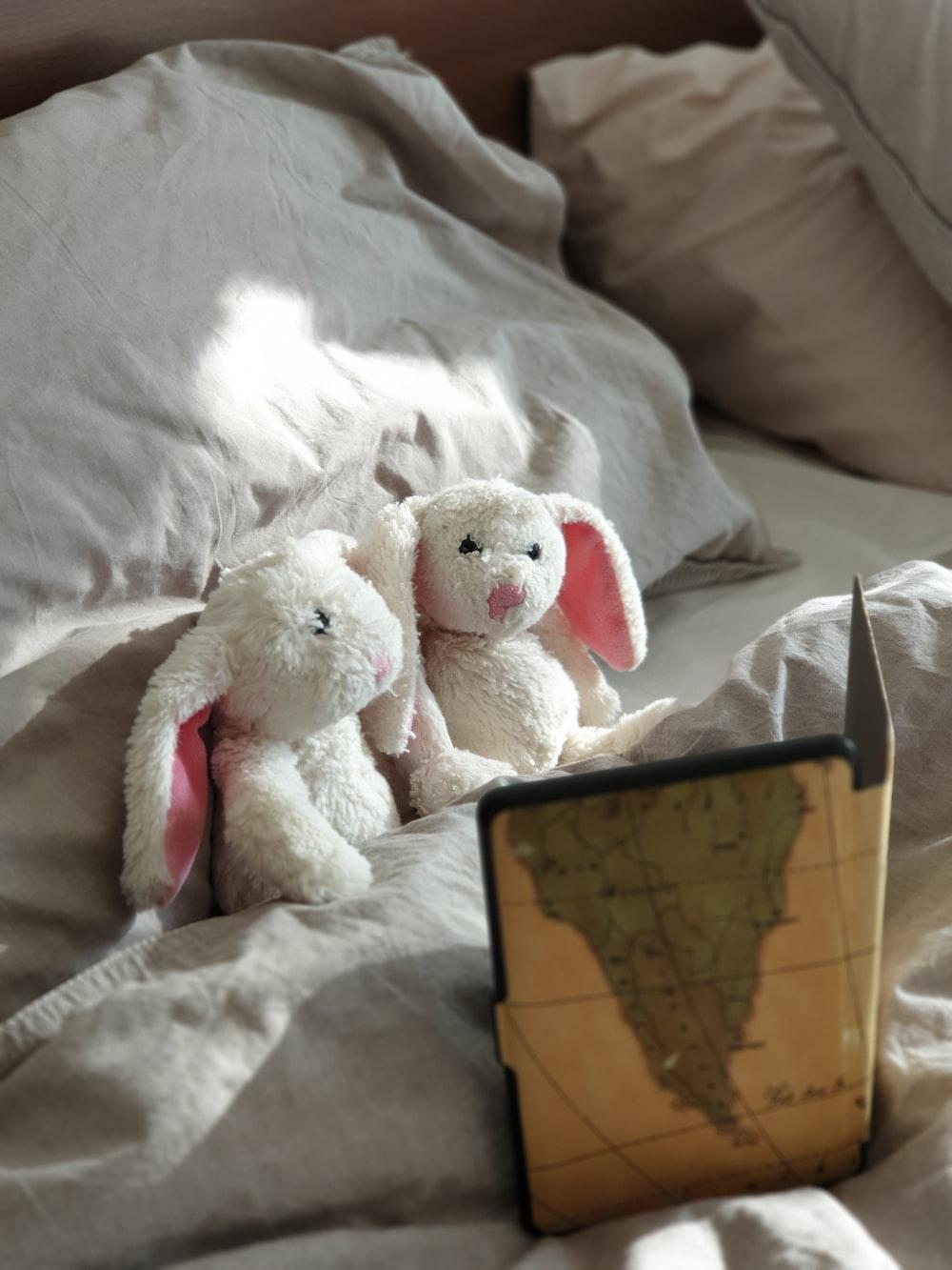 white bear plush toy on white textile