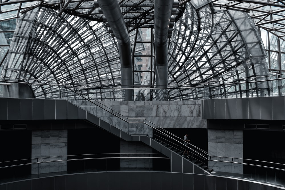gray concrete building with glass roof